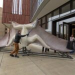 Model of a giant prehistoric pterosaur is rolled into the U-M Biological Sciences Building, the new home of the university's Museum of Natural History. The museum will reopen in its new home next spring. The 700-pound model is a hand-painted fiberglass cast with an internal steel armature.
