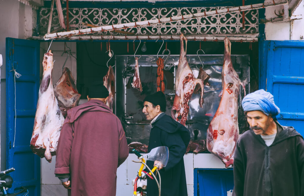 Customers buying foods at an open air meat market Morocco. Image credit: iStock