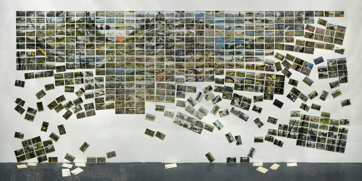 """David Opdyke, This Land, wall mural of vintage postcards modified with gouache and ink, which is part of the exhibition """"David Opdyke: Paved with Good Intentions"""" on view at the U-M Institute for the Humanities Gallery Jan. 25–Feb. 27."""