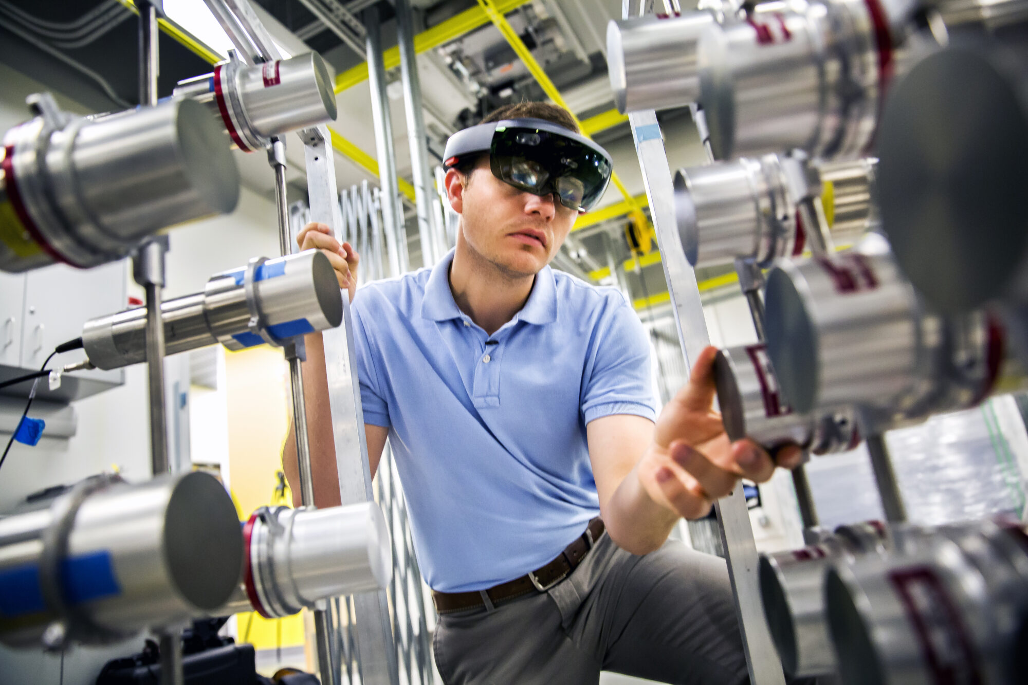 Michael Hamel, NERS Ph.D. Student, uses a Microsoft Hololens headset with a radiation imaging array to demonstrate the use of augmented reality to find nuclear materials hidden in a room. Image credit: Joseph Xu, Michigan Engineering