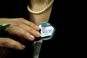 Sara Pozzi adjusts the tag that monitors her exposure to radiation in the laboratory. Image credit: Joseph Xu, Michigan Engineering