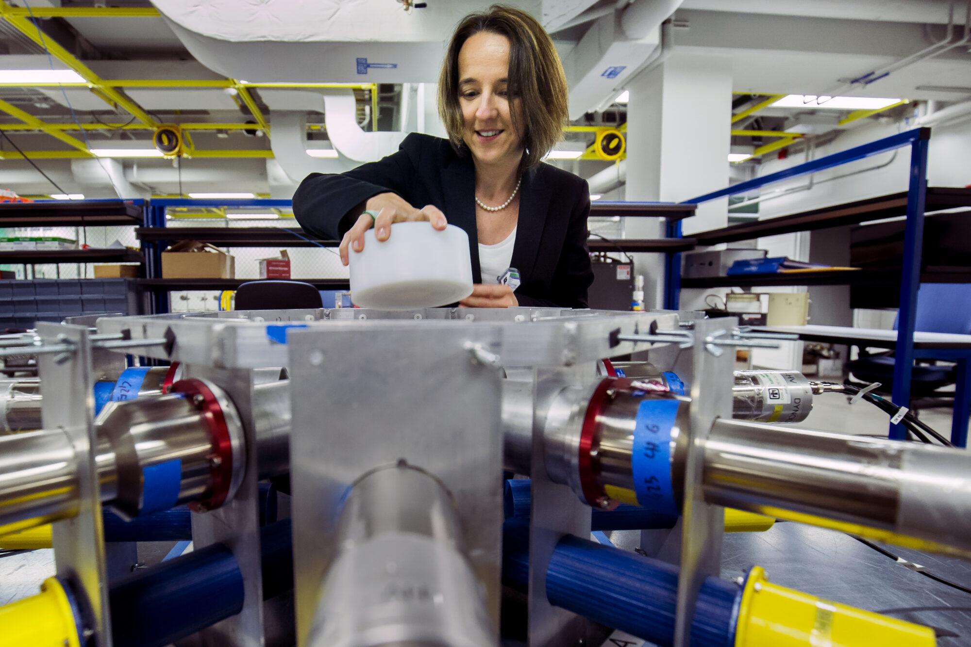 Sara Pozzi puts a radioactive sample into an array of detectors that identify and measure uranium and plutonium. Image credit: Joseph Xu, Michigan Engineering