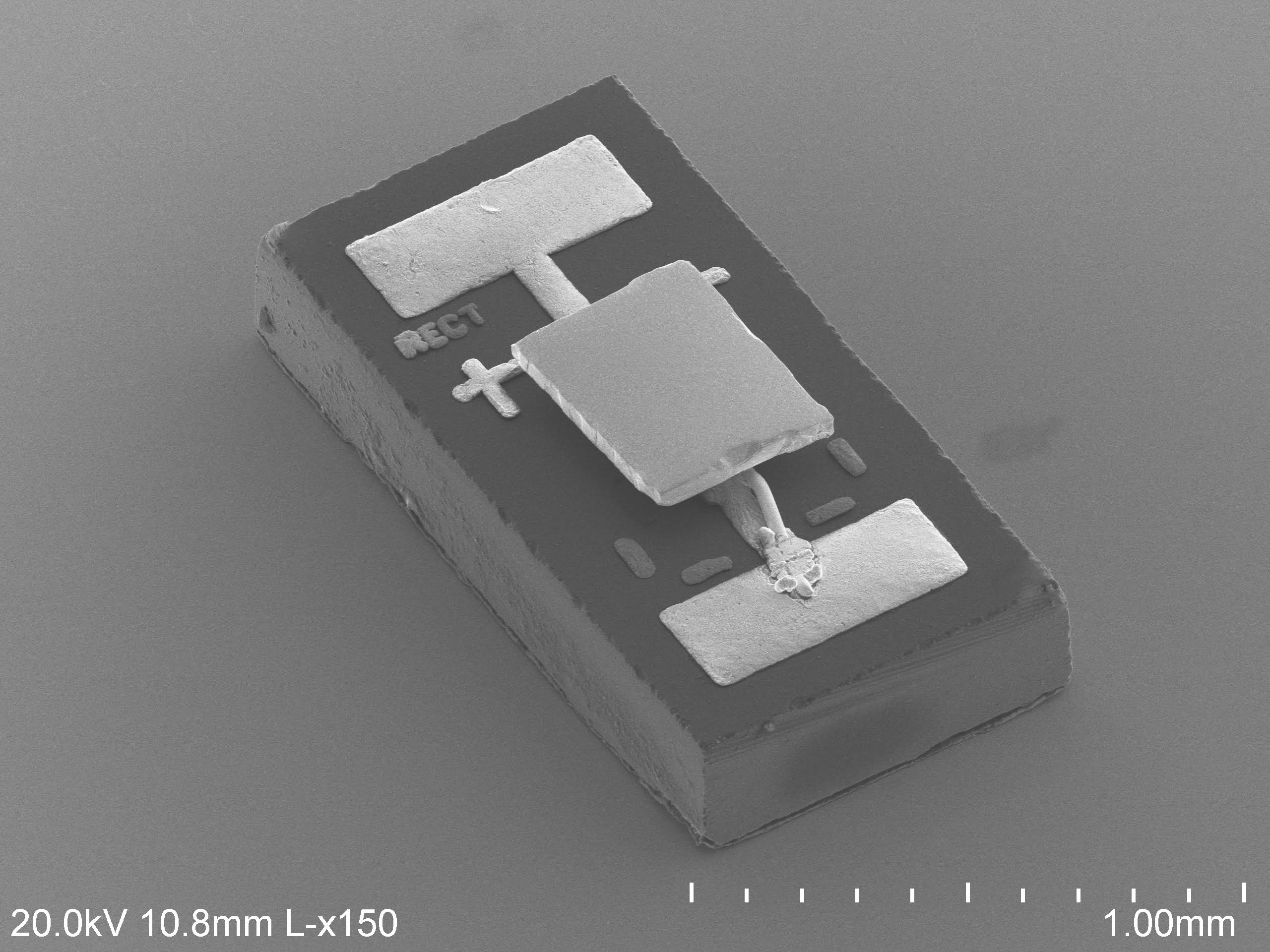 The U-M team modified an infrared photodiode about the size of a grain of rice, shown in this electron microscope image. They smoothed its surface so that they could place it in close proximity to a custom-made calorimeter, just 55 nanometers (0.000055 millimeters) between them. The calorimeter's measurements showed that the photodiode, when run with electrodes reversed, behaved as if it were at a lower temperature, and cooled down the calorimeter. Image credit: Linxiao Zhu