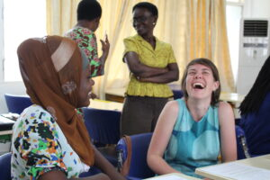 Mary Lewallen laughs with her Ghanaian colleague as they practice delivering Relationship Tidbits, a sexual violence primary prevention intervention adapted from the University of Michigan's Relationship Remix. Image courtesy: U-M School of Nursing