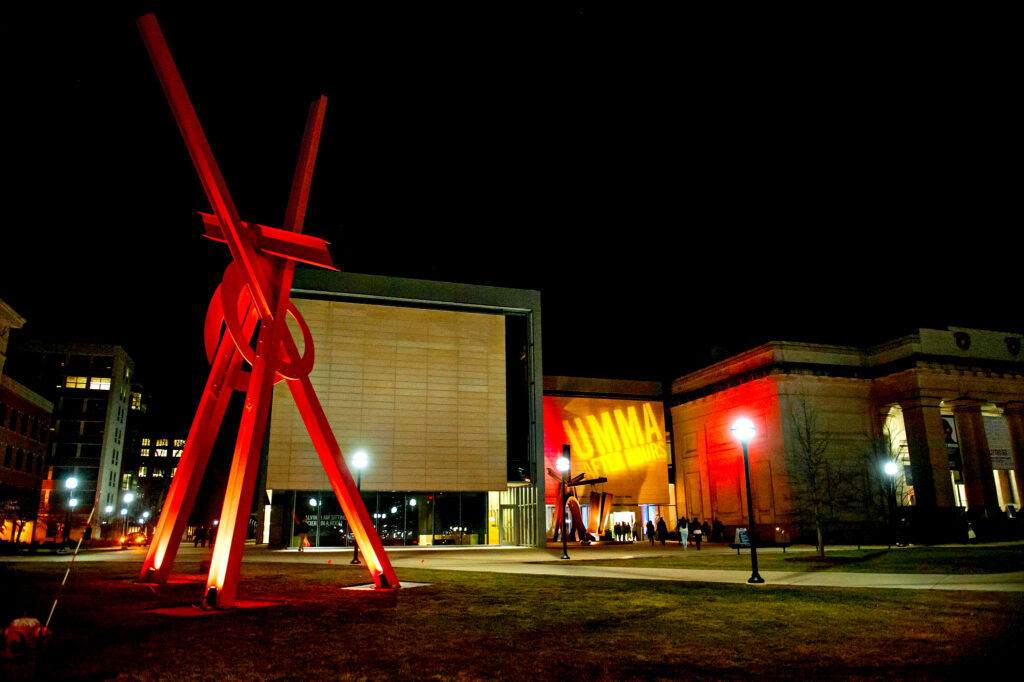 "Mark di Suvero's sculptures ""Orion"" (foreground) and ""Shang"" (background) have welcomed visitors to the U-M Museum of Art since 2009. After a year of restoration work, ""Orion"" returns to campus April 2019."