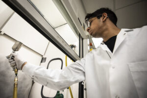 Abhishek Dhyani, Macromolecular Science & Engineering PhD Student, sprays a low interfacial toughness (LIT) coating onto a surface. Image credit: Joseph Xu, Michigan Engineering