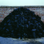 Liu Bolin, Hiding in the City, No. 95, Coal Pile, 2010, chromogenic print. Courtesy of Eli Klein and the artist, © Liu Bolin
