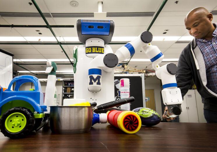 """Robot """"Odd Job"""" reaching for an object"""
