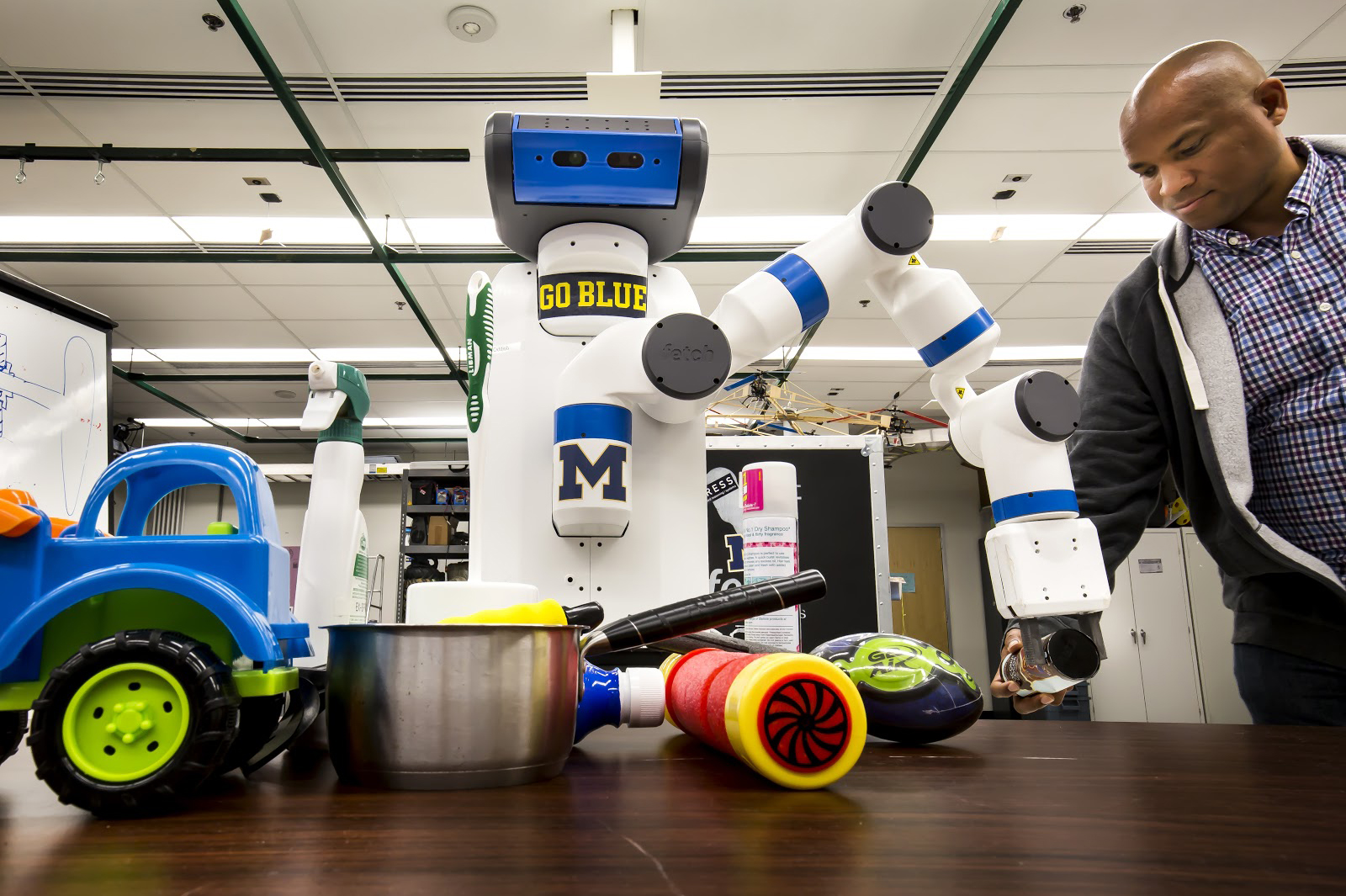 Odd Job, one of two robots in CSE Associate Professor Chad Jenkin's lab, grabs for an object. Odd Job and its double, Cookie, currently are able to grab objects based on depth and color perception. Image credit: Joseph Xu, Michigan Engineering