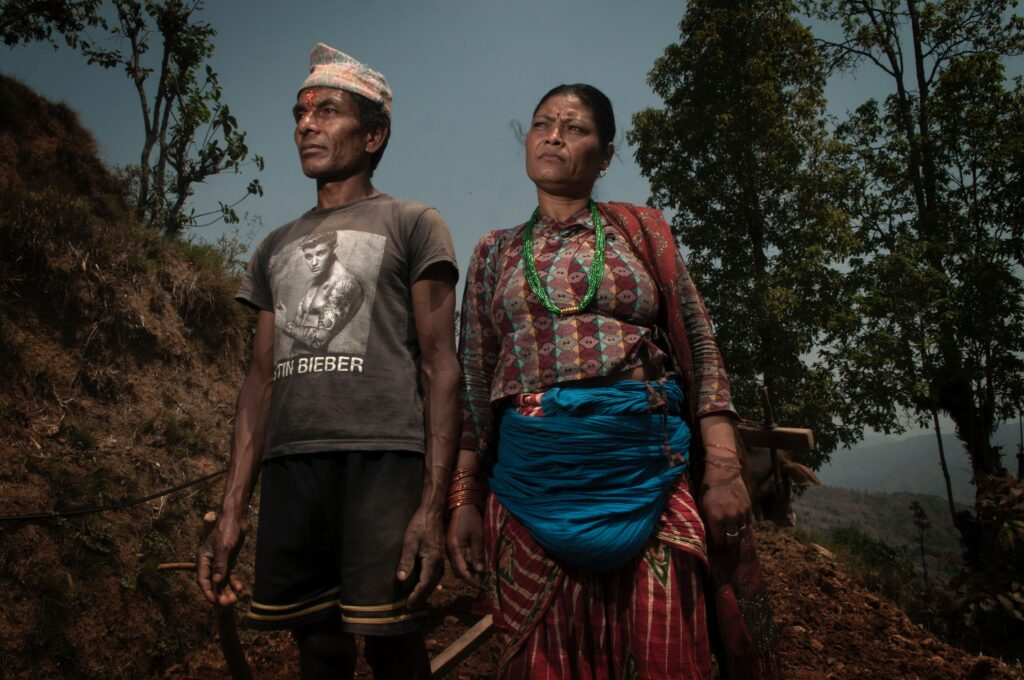 Photo of a man and woman from Nepal in forest.