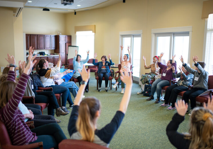 U-M students from Anne Mondro's Memory, Aging and Expressive Arts class University of Michigan Penny W. Stamps School of Art & Design work on a movement activity with participants at Brecon Village in Saline, MI. Eric Bronson/Michigan Photography.