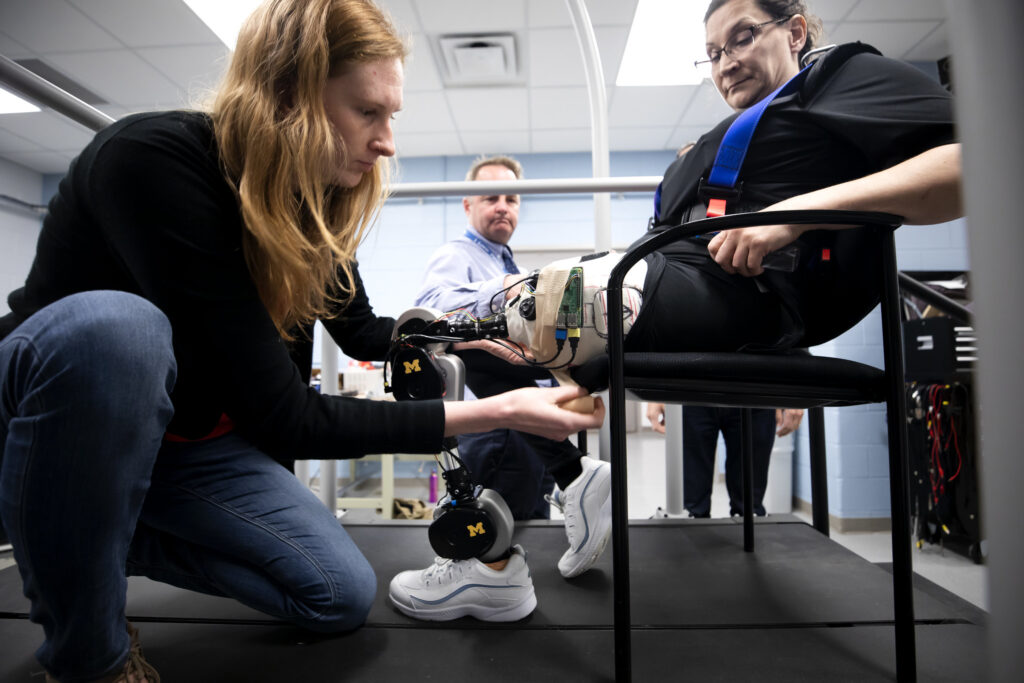 Kim Ingraham, ME PhD Student and member of the Neurobionics Lab, runs tests on an open-source robotic leg with Dawn Jordan Musil. Image credit: Joseph Xu, Michigan Engineering