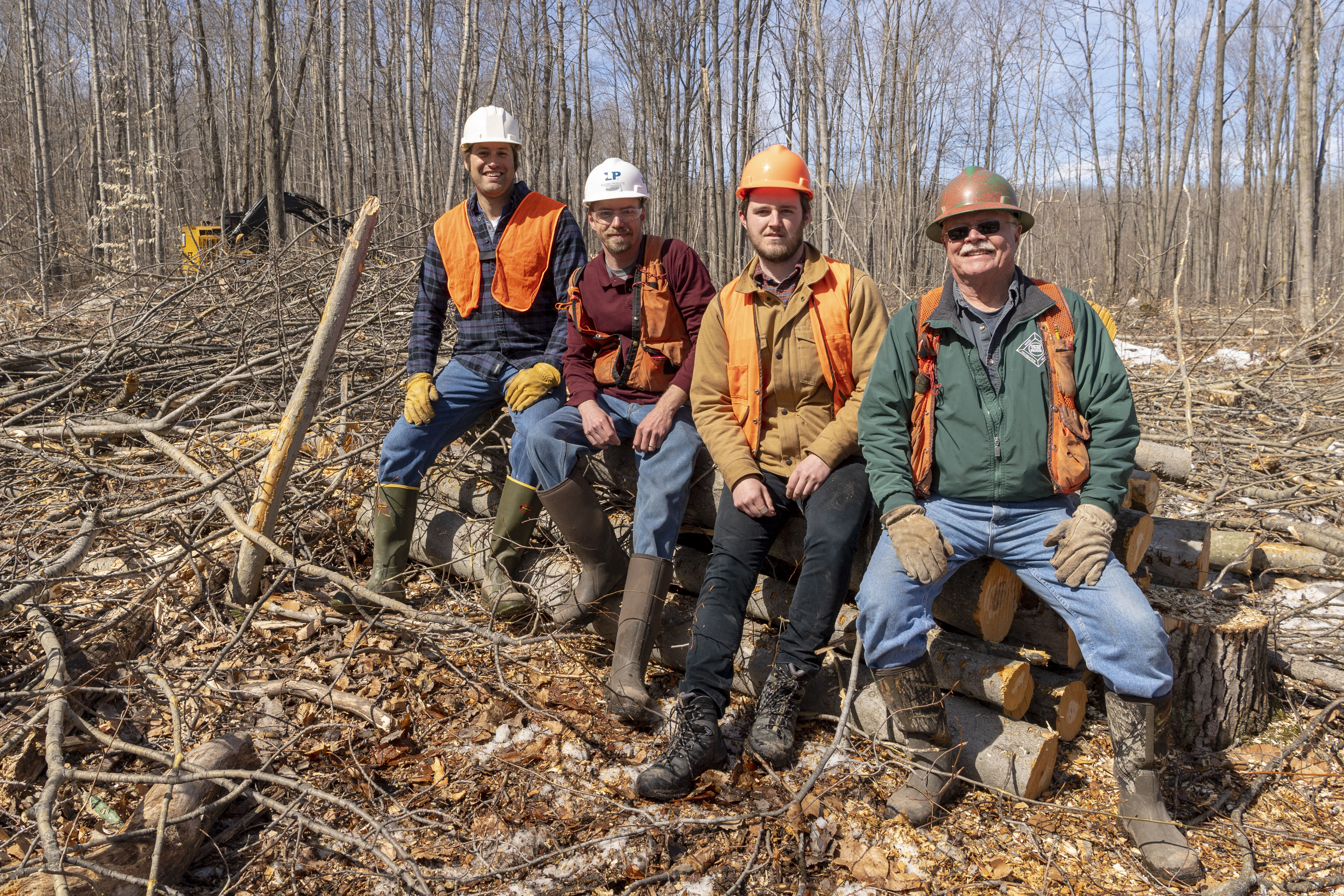 From left, U-M ecologist and biogeochemist Luke Nave; Travis Kangas, a resource manager at Louisiana-Pacific Corporation; U-M research specialist John Den Uyl; and Dean Reid, the consulting forester who set up the timber sale. Image credit: Roger Hart, Michigan Photography