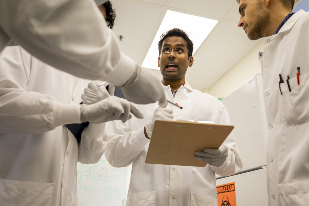 BME Assistant Research Scienstist Ramkumar Tiruvannamalai Annamalai goes through the process steps with his team to develop injectable cell clusters that create micro-climates accelerating bone regeneration. Image credit: Robert Coelius/Michigan Engineering