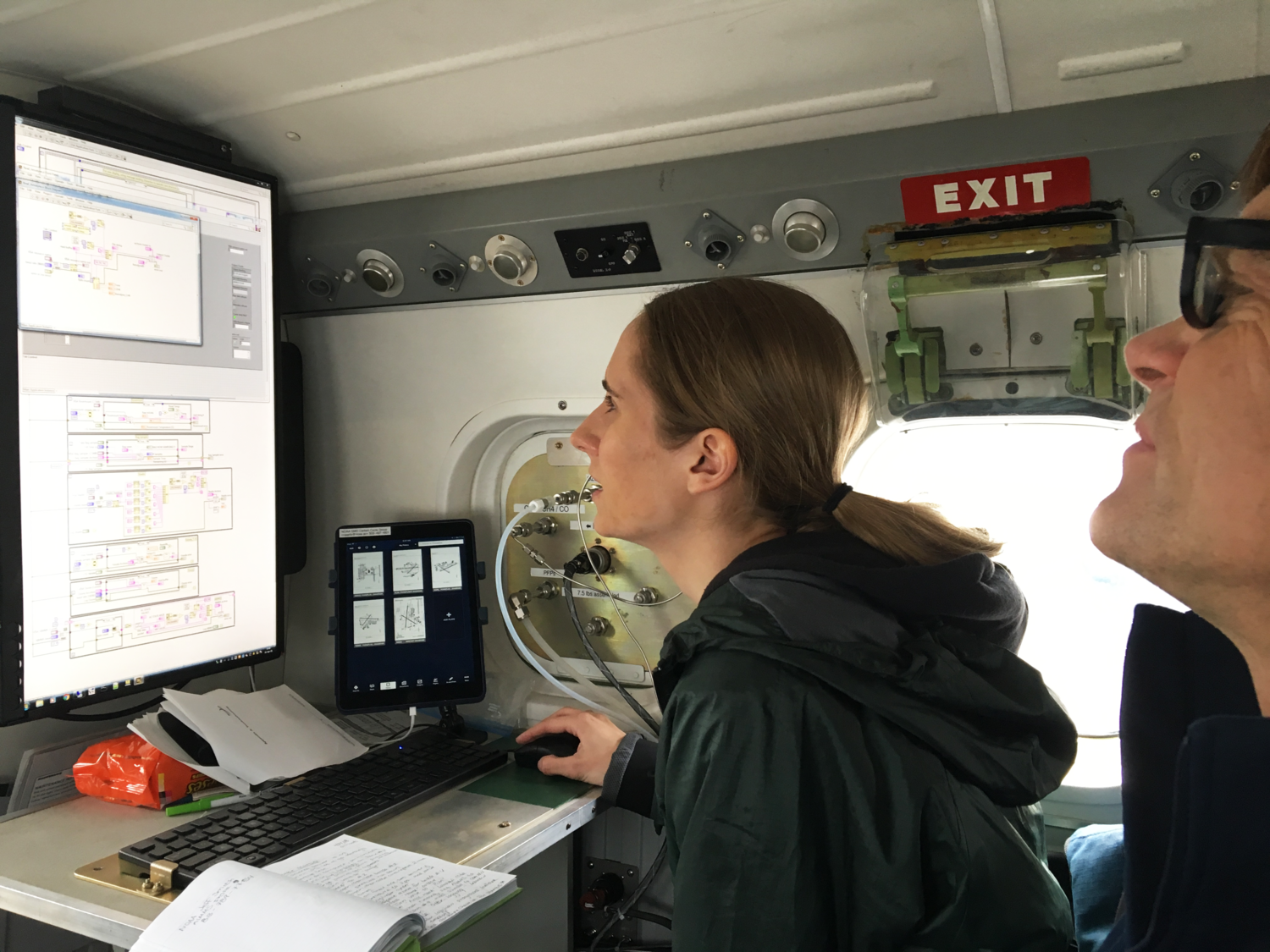 Genevieve Plant and Colm Sweeney review measurements of methane and other gases during an airborne research project in 2018. Image credit: Eric Kort, University of Michigan