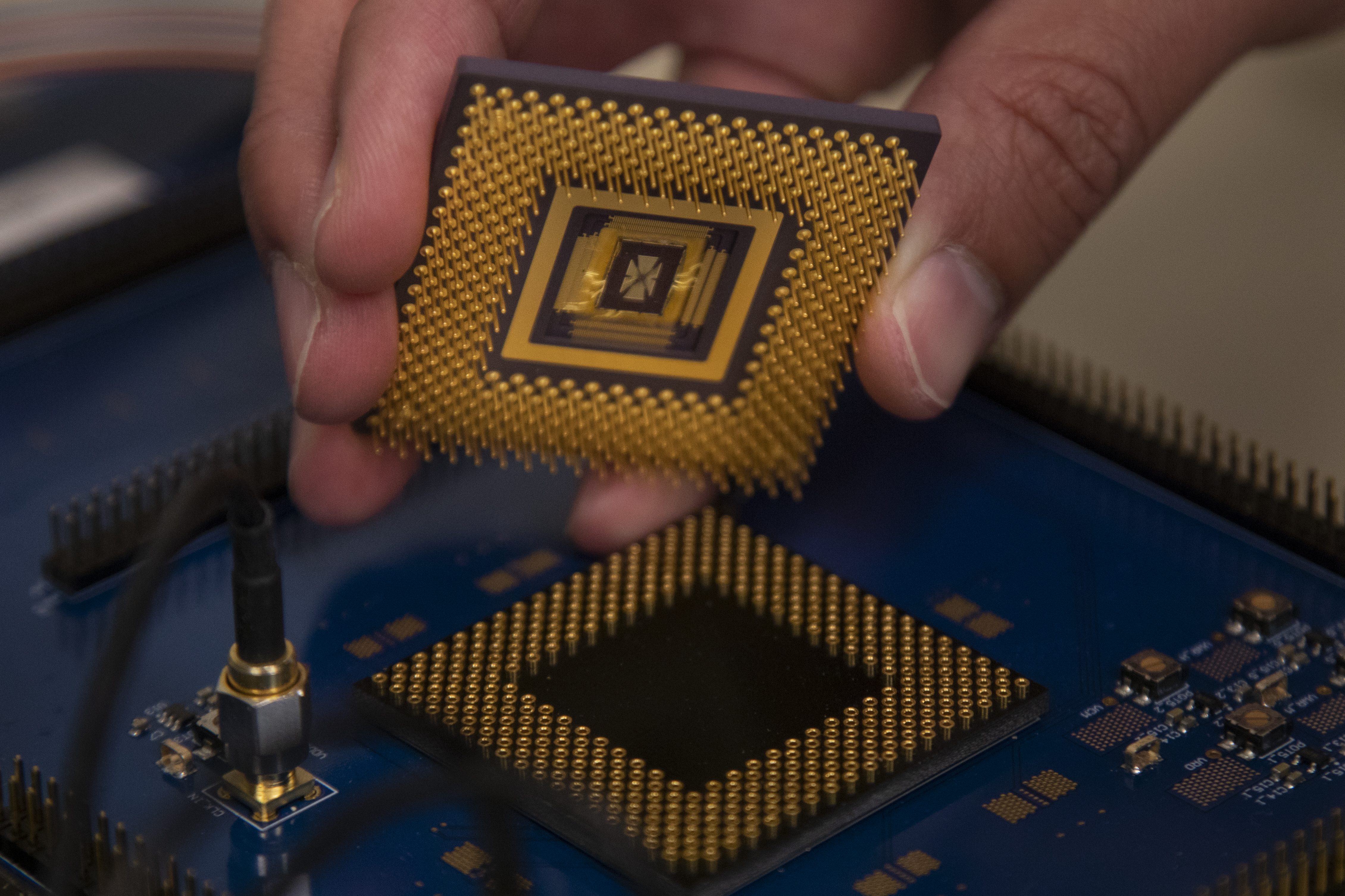 The memristor array chip plugs into the custom computer chip, forming the first programmable memristor computer. The team demonstrated that it could run three standard types of machine learning algorithms. Image credit: Robert Coelius, Michigan Engineering