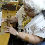 Gigi, age 92, 3D-printer pen creating tree sculpture.