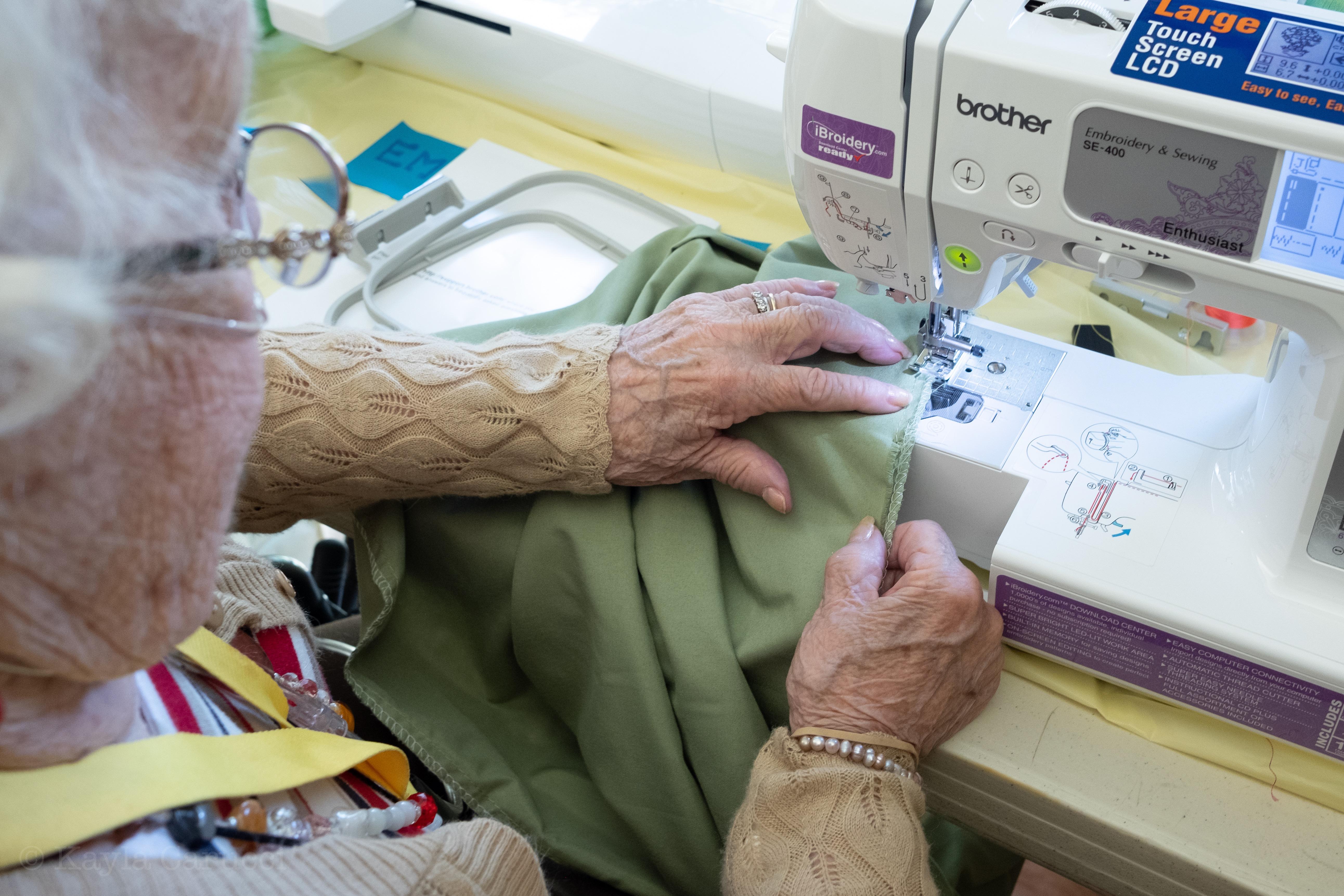 Gigi, age 92, fixing pillowcase
