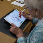 Rosalind, age 98, painting fruit.
