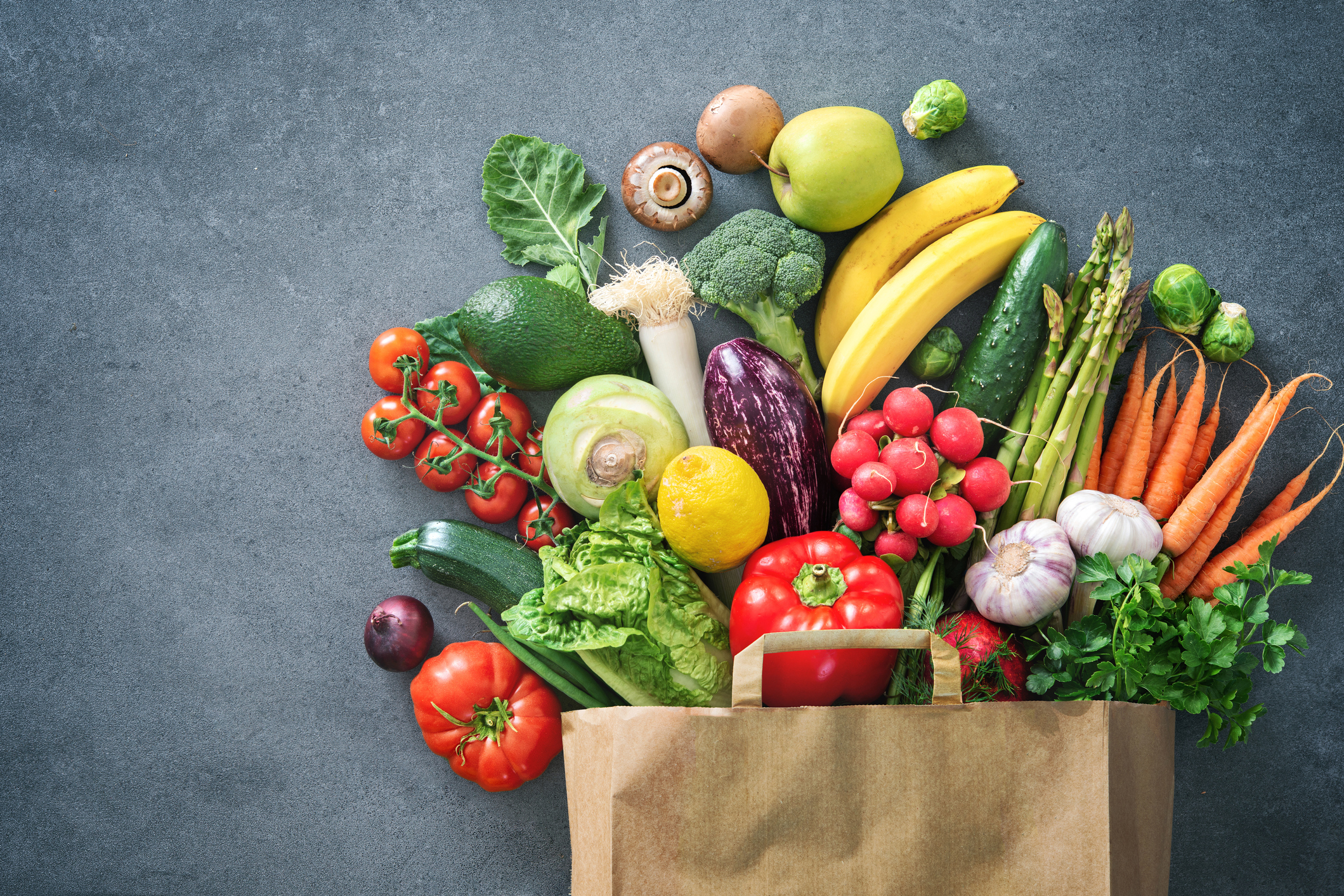 Healthy food selection. Shopping bag full of fresh vegetables and fruits. Image credit: iStock