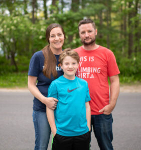 Rhys and his parents. Image credit: Eric Bronson, Michigan Photography