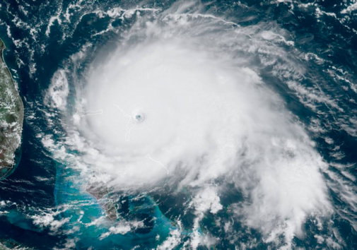 Hurricane Dorian at peak intensity as a Category 5 hurricane making landfall on the Abaco Islands in the Bahamas, September 1, 2019. In the left of the image is the coast of Florida. Image courtesy National Oceanic and Atmospheric Administration's GOES-East