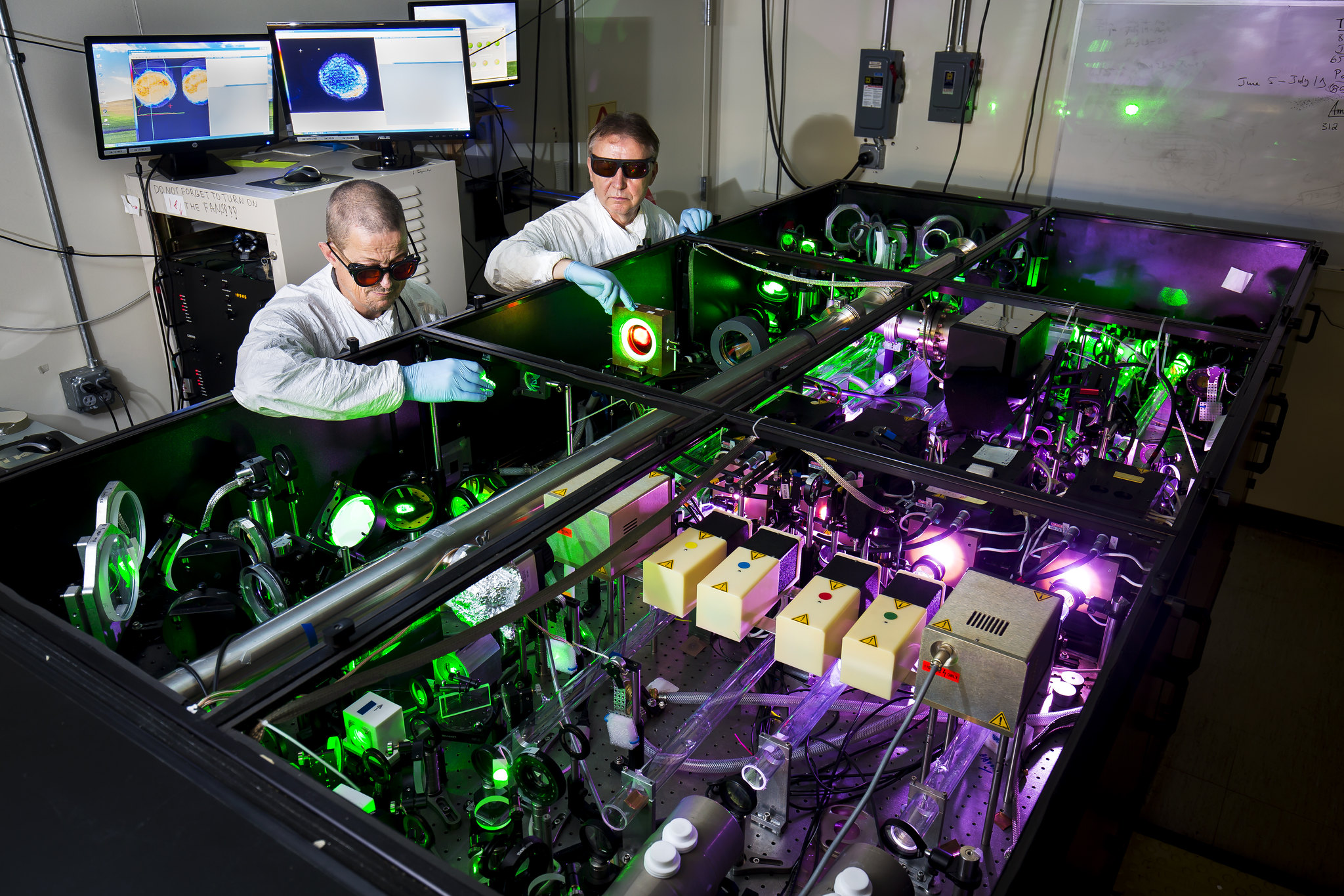 Anatoly Maksimchuk, EECS Research Scientist, and John Nees, EECS Associate Research Scientist, demonstrate use of the HERCULES 300 TW laser. Image credit: Joseph Xu, College of Engineering