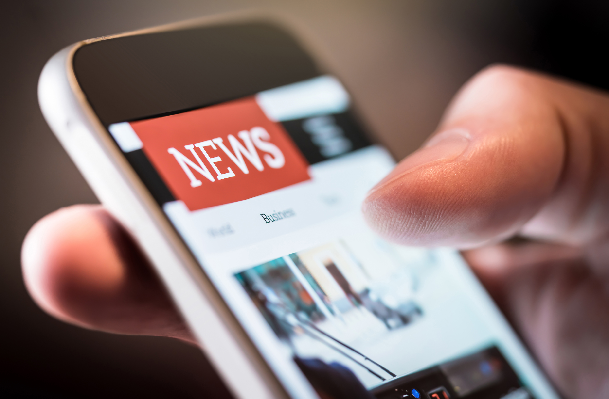 Image of a news on a smartphone. Image credit: iStock