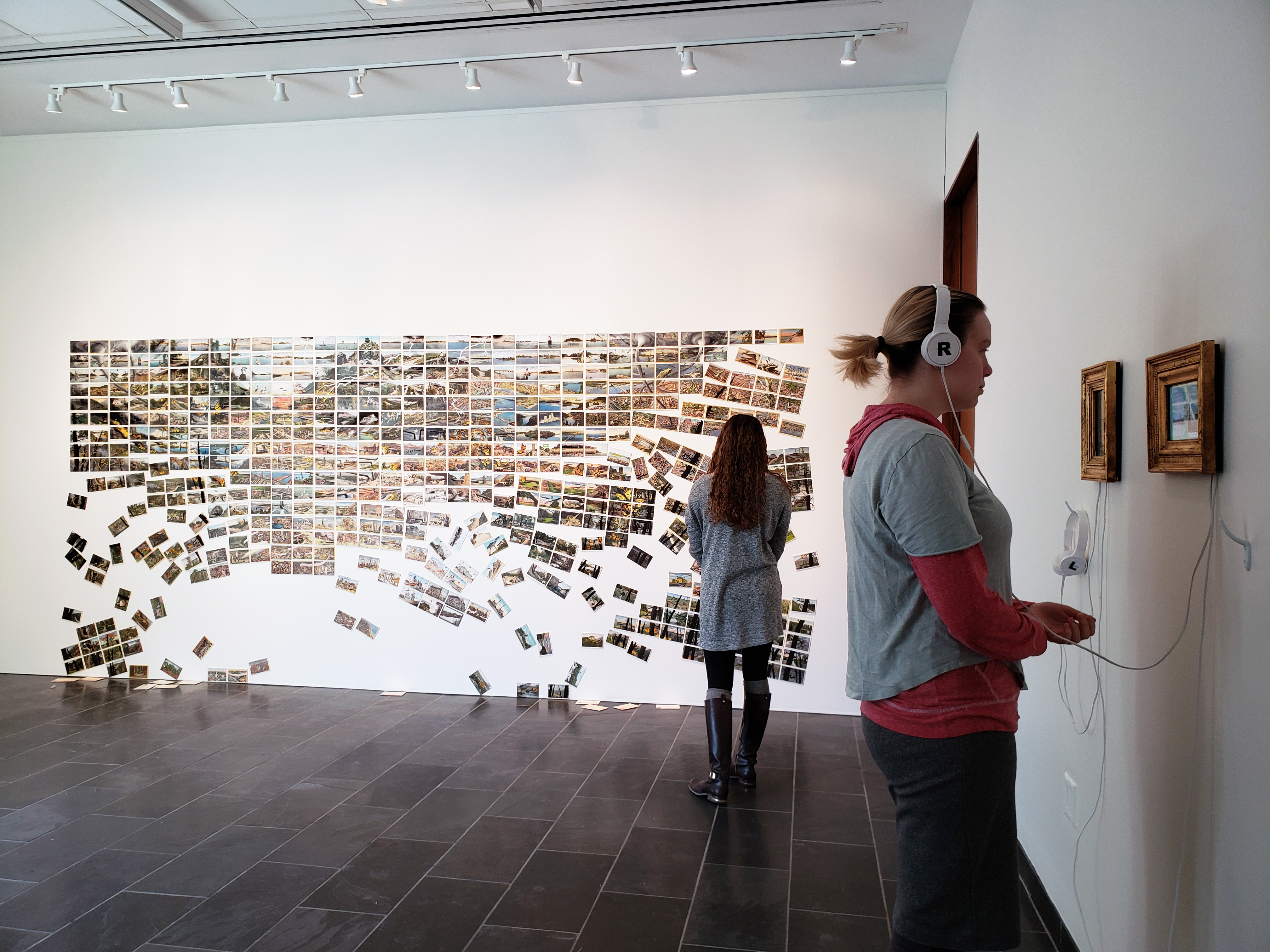 """Students at """"Paved with Good Intentions"""" exhibition by David Opdyke"""