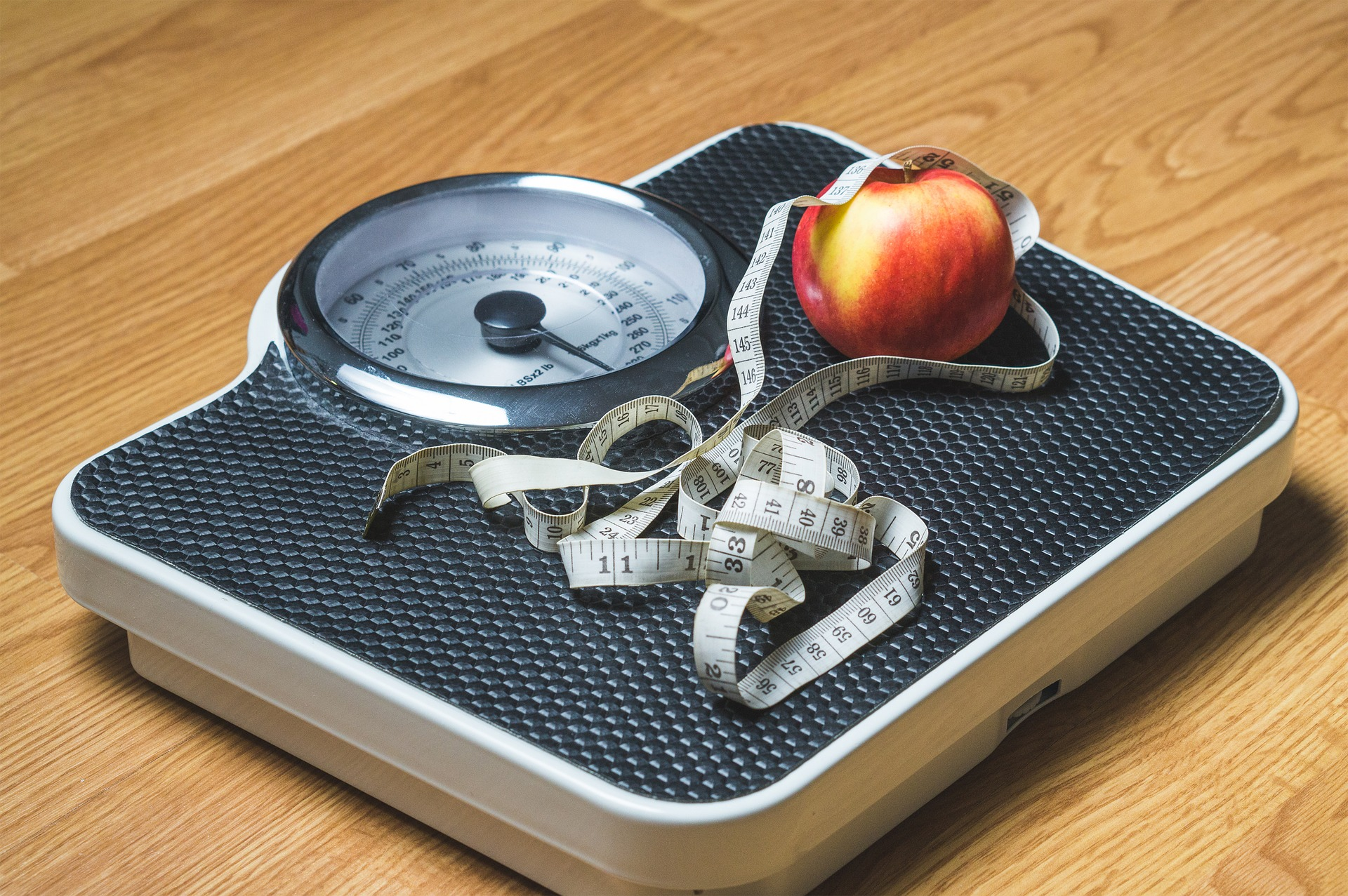A scale, measuring tape and an apple. Image credit: Pixabay user, TeroVesalainen