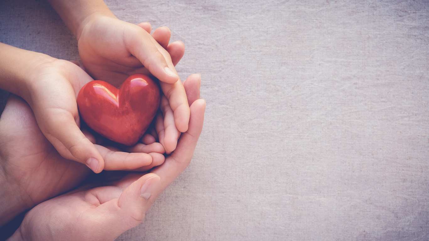 Hands holding heart. Image credit: iStock