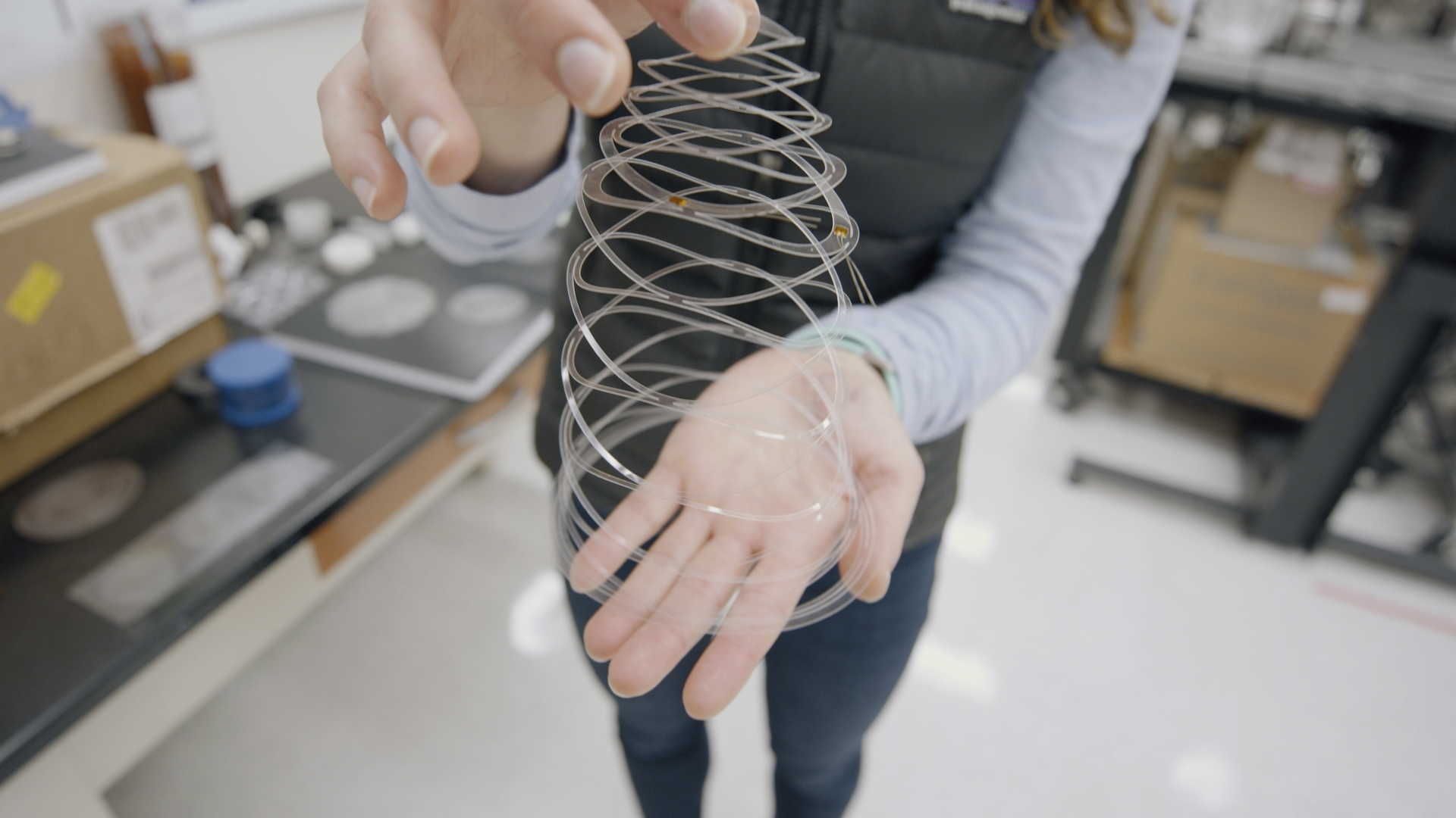Erin Evke demonstrates how the kirigami cut pattern opens into a lacework. Image credit: Levi Hutmacher, Michigan Engineering
