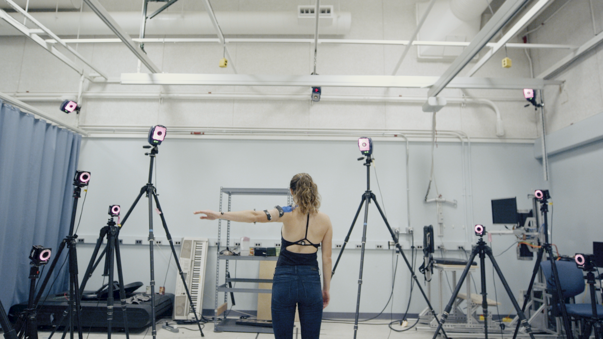 The motion capture cameras and kirigami sensor pick up first author Erin Evke's arm movements, enabling the team to match the reading from the sensor to the position of her shoulder. Image credit: Levi Hutmacher, Michigan Engineering