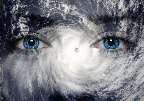 Eyes over an overhead photo of a hurricane. Image credit: iStock