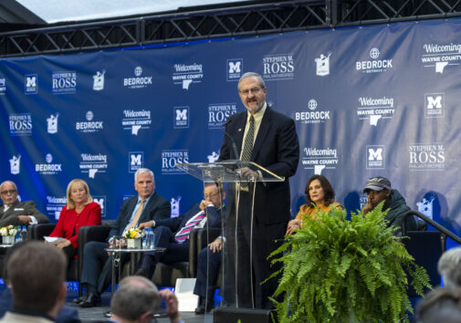 University of Michigan President Mark Schlissel speaks during a press conference announcement of the Detroit Center for Innovation in downtown Detroit on Oct. 30, 2019. Behind him (left to right) are Wayne County Executive Warren Evans, U-M Regent Denise Ilitch, Bedrock CEO Matt Cullen, Related Cos. Chairman Stephen M. Ross and Michigan Governor Gretchen Whitmer. Credit: Scott Soderberg, Michigan Photography.