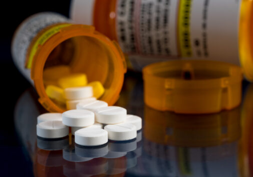 Oxycodone opioid tablets with prescription bottles. Image credit: iStock