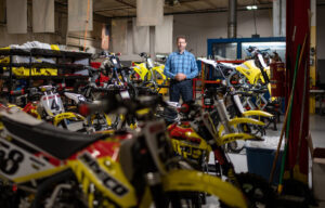 Sean Hilbert among the motorcycles. Image credit: Eric Bronson, Michigan Photography