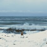 Waves break against the shore in the wintertime Arctic, leading to sea spray aerosols. Image credit: Kerri Pratt