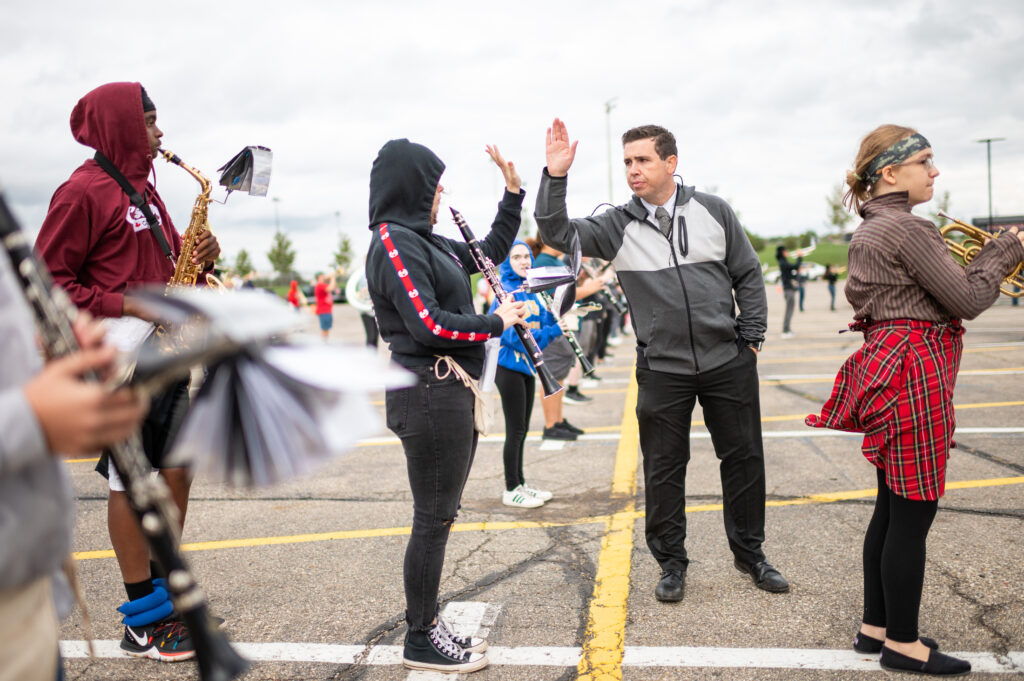 This is Michigan, Stories of our state. Northwest Band in Jackson. Director and student high five.