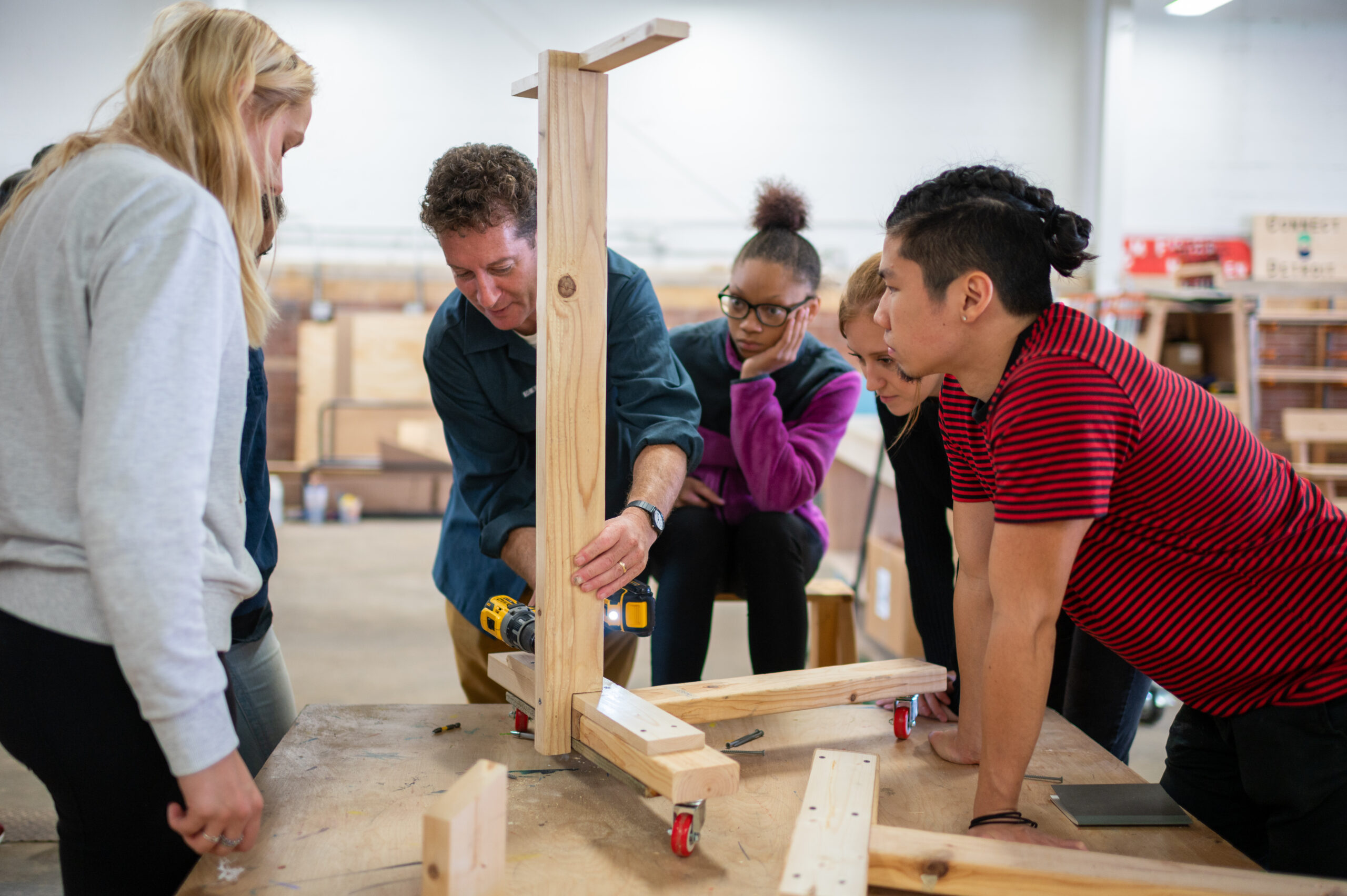 Nick Tobier works with students on hands-on projects at Brightmoor. Image credit: Eric Bronson, Michigan Photography