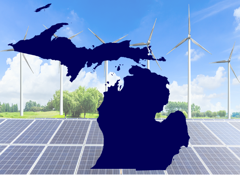 A silhouette of Michigan against a backdrop of windmills and solar panels