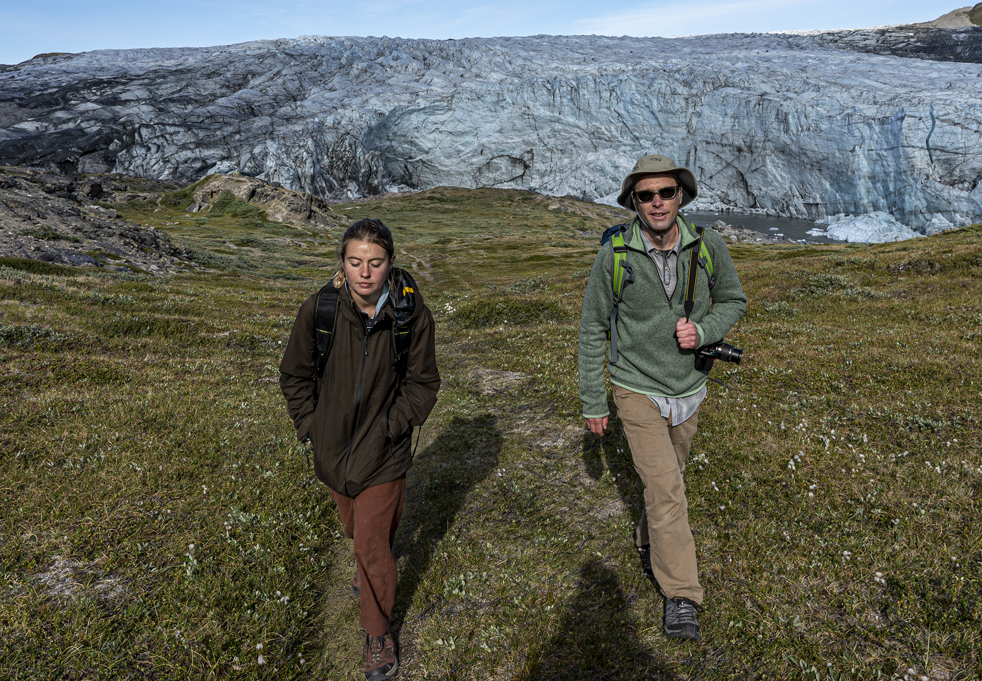University of Michigan College of Engineering student Abigail Meyer (left) and Mark Flanner (right), associate professor in Climate and Space Sciences and engineering in the University of Michigan College of Engineering, in front of the Russell Glacier in Greenland.