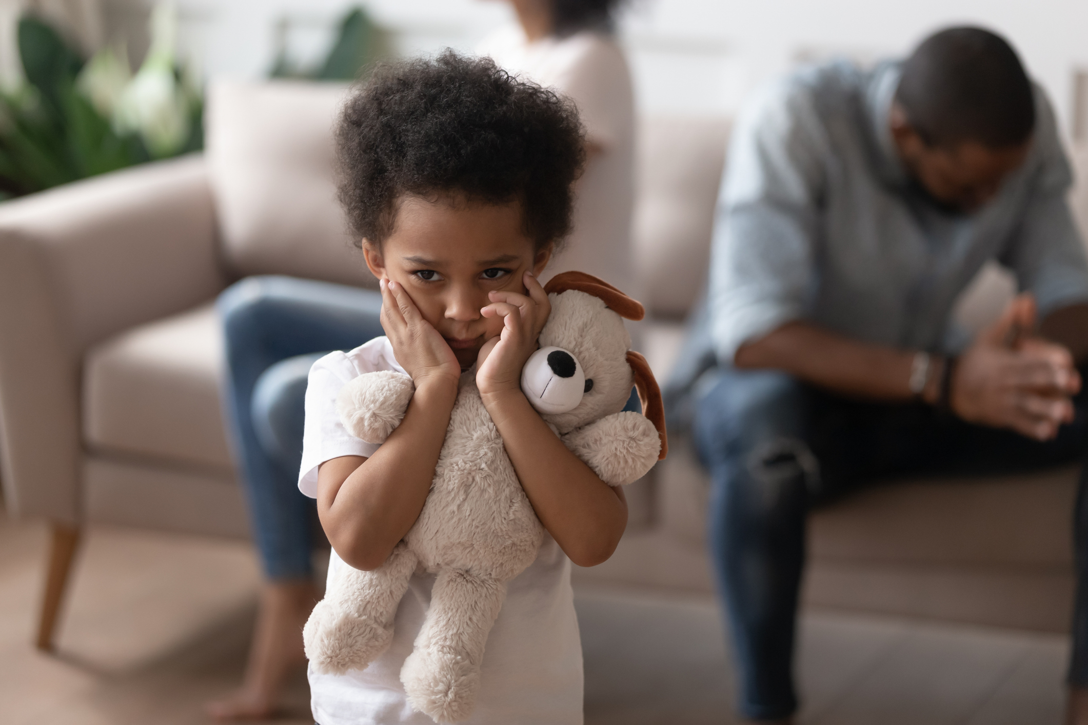 Image of small child holding a teddy bear.