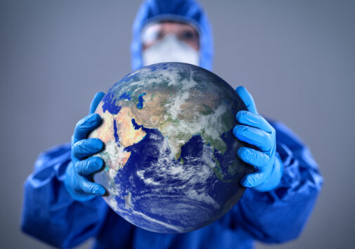 Doctor holding the globe/ Image credit: iStock
