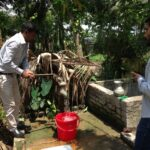 Preparing to collect a well water sample. Image credit: R. Reddy