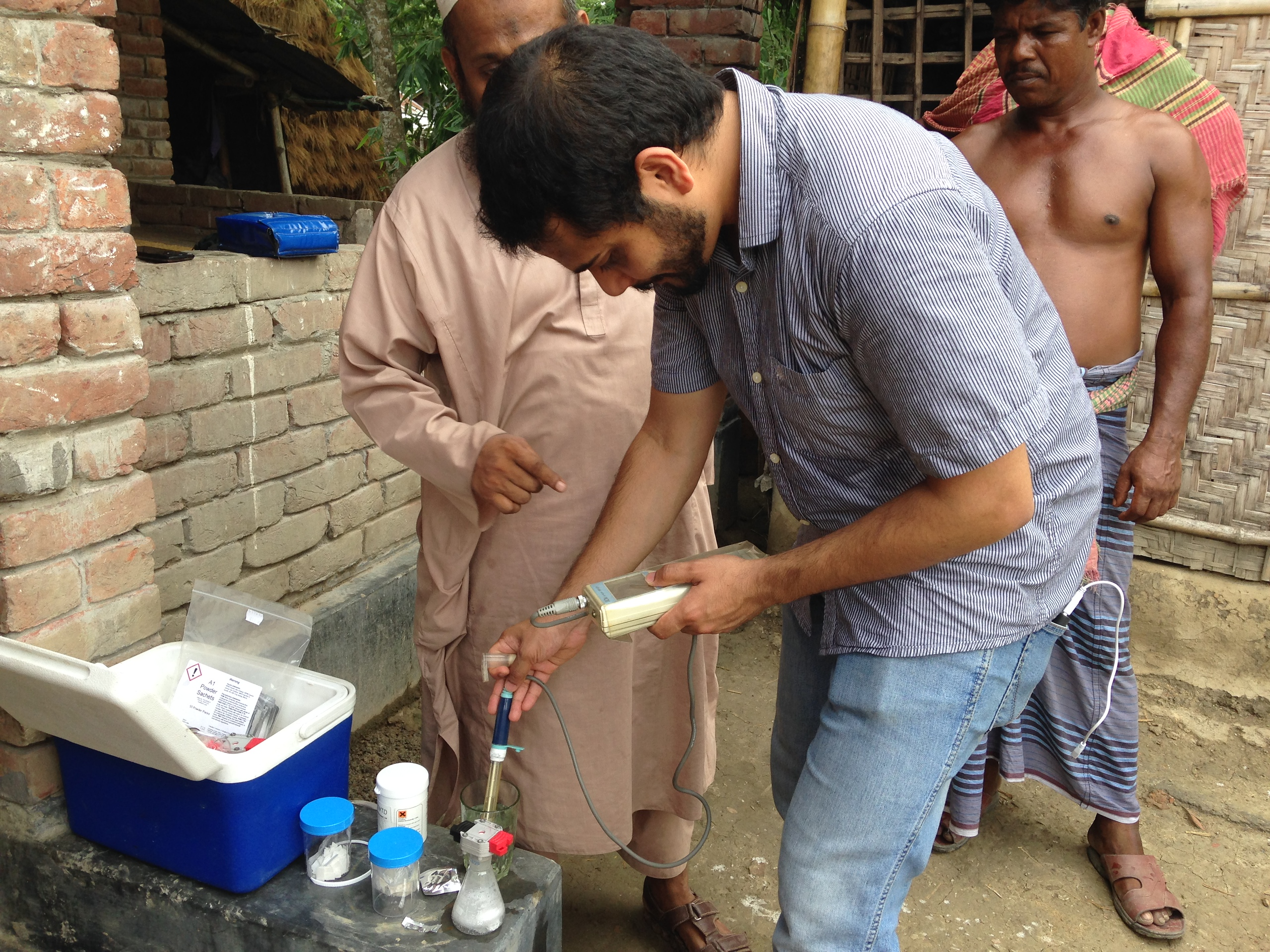 A research uses a testing kit to check for arsenic in water in a beaker