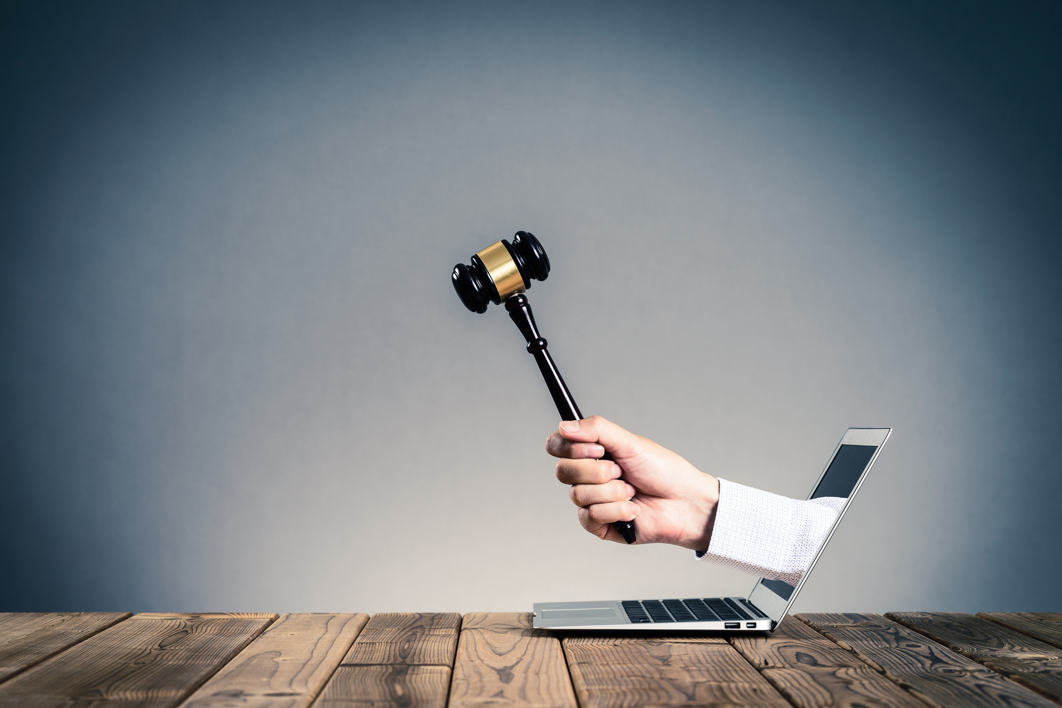 Image signifying online justice of gavel hitting the table. Image credit: iStock