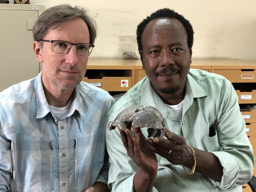Drs. S. Semaw (right) and M. Rogers with the DAN5 cranium. Image credit: Dr. Michael J. Rogers, Southern Connecticut State University