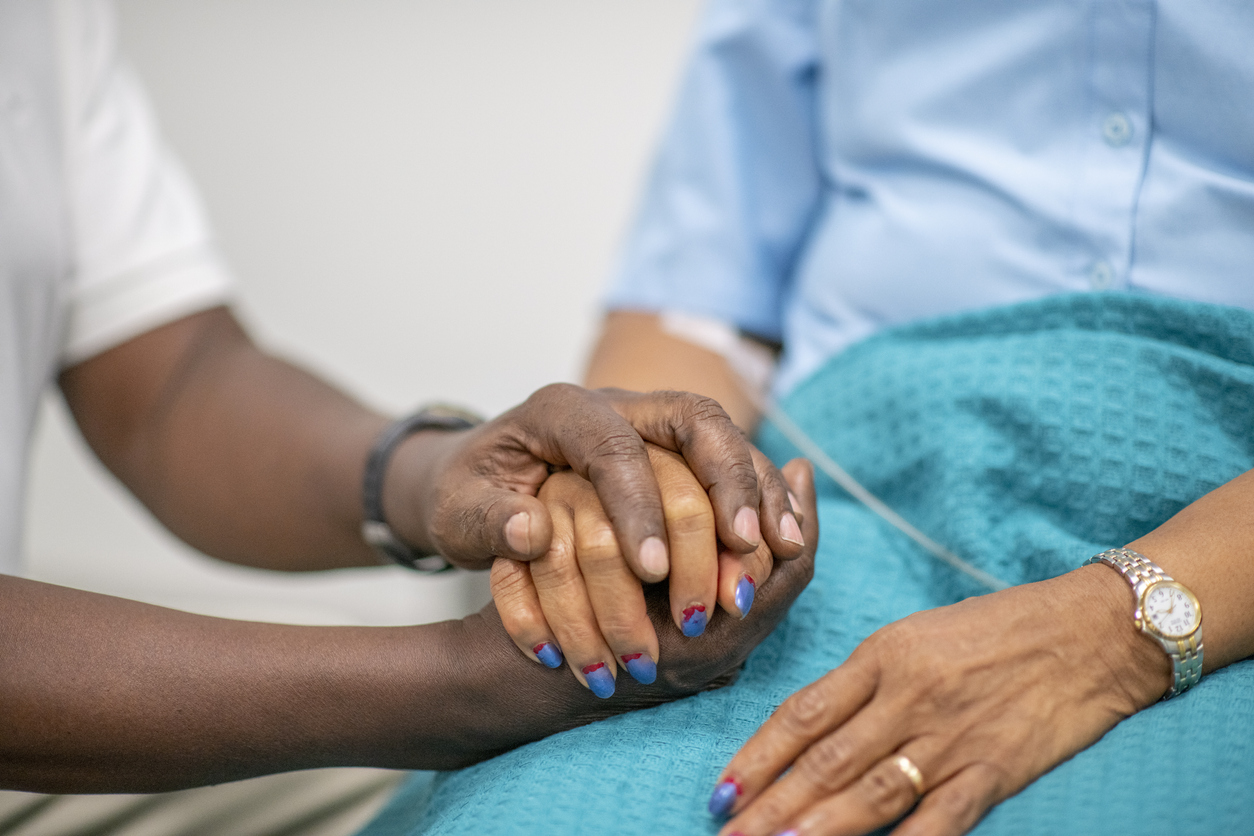 African American patient and comfort provider. Image credit: iStock