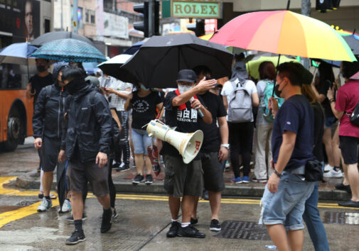 Hong Kong Protestor Directing Traffic. Image credit: iStock